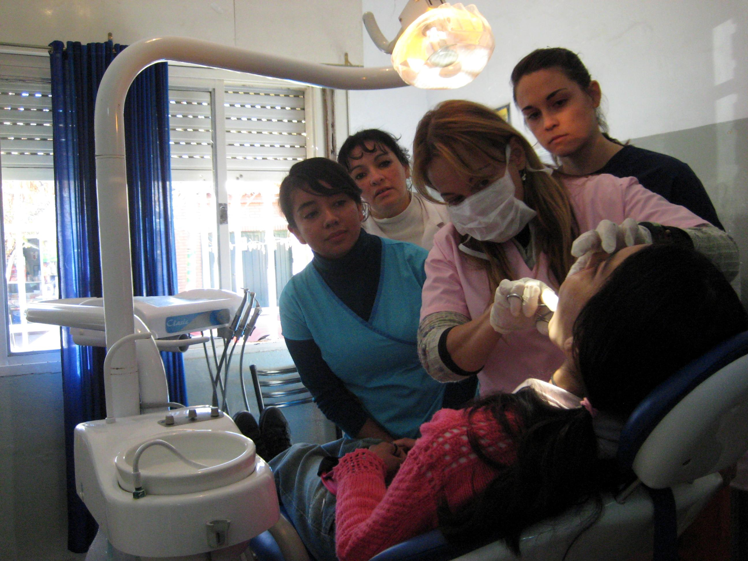 Projects Abroad Dentistry staff learn how to examine the patients mouth during Dentistry internships in Argentina.